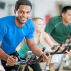 Group of people in the gym doing cardio cycling training